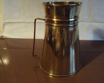 Rare and very old water brass pot dating from the 1930s.
