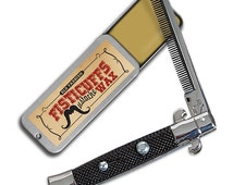 Fisticuffs switchblade comb and wax