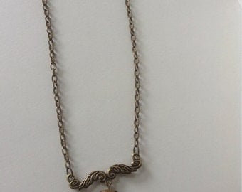 Bronze chain with bronze scroll style focal piece natural turquoise stone.