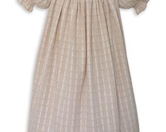 Girls hand smocked cream organic cotton bishop dress.  6m, 12m and 18m.  Pink roses hand embroidered around the collar. 16692