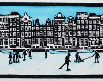 Amsterdam canal print, handmade painted lino print, Keizersgracht, frozen winter canal with skaters, limited edition. Mounted, unframed.