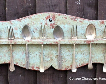 Painted primitive 19th century American style spoon rack