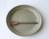 greenish grey dessert plate with carved dot