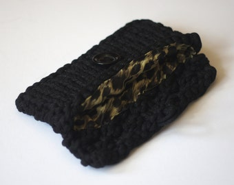 knitted t-shirt yarn clutch/handbag, lined with a button fastening