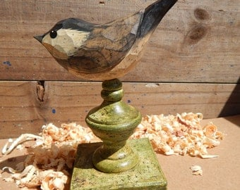Hand Carved Bird Chickadee carved from White Pine.  Perched on antiqued finial.