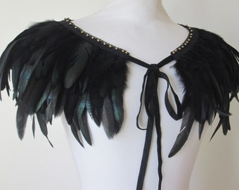 Black feather capelet cape with bead detailing and ribbon ties.