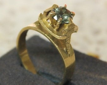9 ct solid gold dress ring with a light-green center stone