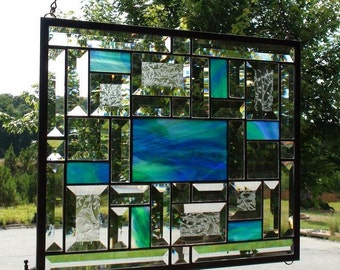 Beautiful Royal Blue & Green stained glass panel with 34 beveled pieces and features the beautiful Wissmach Stained Glass