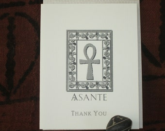 A box of beautiful African centered  individually printed notecards on linen recycled paper. Blank inside.