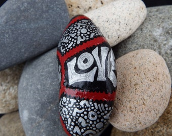 Painted Rock,Original Design,One of a kind, Black, Silver,Crimson. Smooth, fun shape ,All sides completed.Abstract, Artist signed