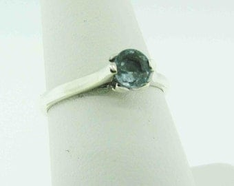 Vintage Sterling Silver ring with light blue stone.