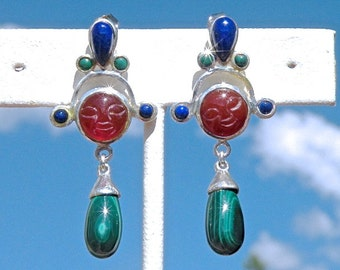 Earrings of Lapis, Malachite, Carnelian with carved faces are festive and lively.