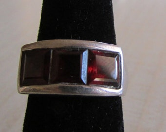 Sterling Silver Ring With 3 Faceted Red Stones  Size 7 1/2