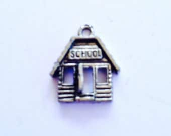 School pewter charm in silver finish.   Package of 12.  Lead safe.  Made in USA.
