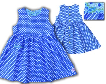 Summer dress for bright blue child with white polka dots
