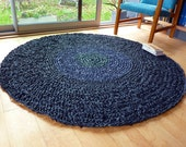 big black round rug - green and blue disc in the center