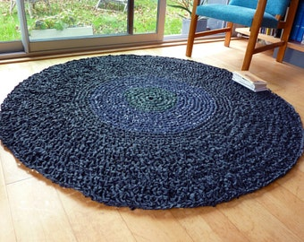 grand tapis noir rond - disque vert et bleu au centre - Expédition offerte