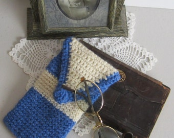 Eye Glasses-case. This classy case is hand crochet in a blue acrylic yarn & contrasting cream color wool.  It has a crochet button closure.