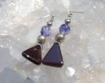 These earrings hang 2 inches.  Glass beads are interspersed with silver beads.