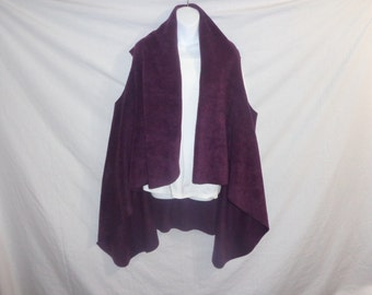 Serape (Sir-wrap-pay) a knee length, wrap-a-round, jacket, shawl, poncho, vest like, very soft outer garment, many colors. Wear it 5 ways
