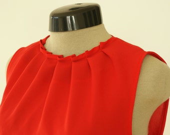 Red chiffon top, folded neckline