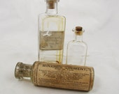 Three Antique Medicine Bottles with Labels and Corks