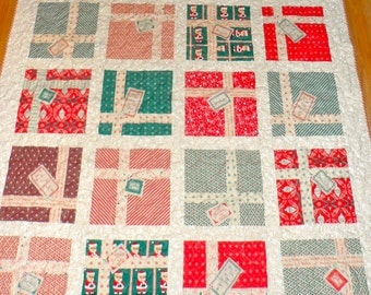 Dear Mr Claus Christmas Finished Quilt Fabrics from Cosmo Cricket Fabrics by Moda A Christmas decoration