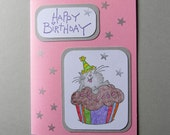 Happy birthday card with cute cartoon cat on cupcake