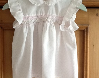 Lovely pink spotty newborn smocked dress with pretty matching hanger