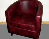 Tub Chair Upholstered In A Wine Faux Leather With Mahogany Wood Legs