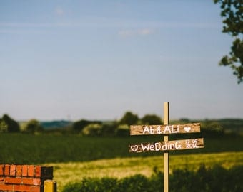 Custom made 'Wedding this Way' sign.