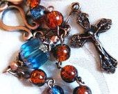 Handmade rosary bracelet: royal blue burnt orange blue cathedral bead in copper
