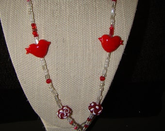 Lanyard/name badge holder with break away magnetic clasp. Hearts and cupcakes in red and white.