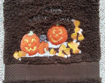 halloween novelty hand towel with pumpkin patch