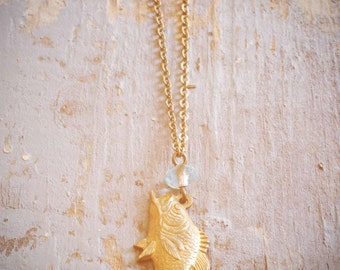 little vintage fish necklace. repurposed old largemouth bass charm & aqua blue czech glass bead on antiqued brass chain. ooak by val b.
