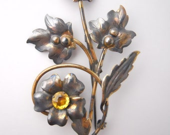 YELLOW RHINESTONE FLOWER brooch, curved stem, numerous leaves, gold filled over sterling