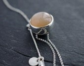 Clear & light peach colored Moonstone solid silver ball necklace