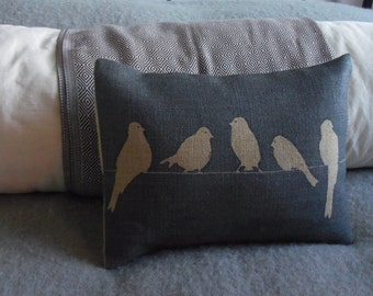 hand printed muted   blue birds on a wire cushion