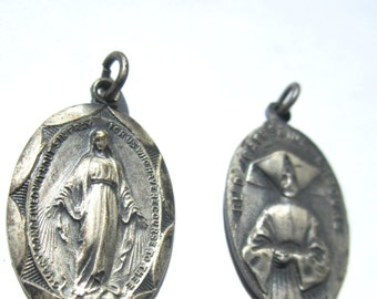 Two 1930s Religious Charms or Pendants