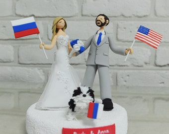 Custom wedding cake topper with their nations' flags