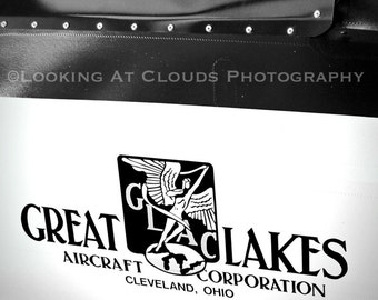black and white aviation photography, airplane art, 30s 1932 biplane logo, aviator, pilot, Great Lakes biplane airplane