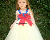 Snow white inspired tutu dress costume comes with matching red bow headband.