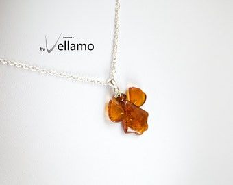 Sterling silver necklace with angel shaped natural Baltic amber pendant, cognac color with inclusions, from Tallinn, Estonia, amber angel