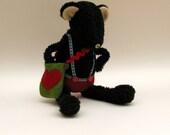 Black Tufty Bear dressed in red felt shorts - Handmade plush sculpture.