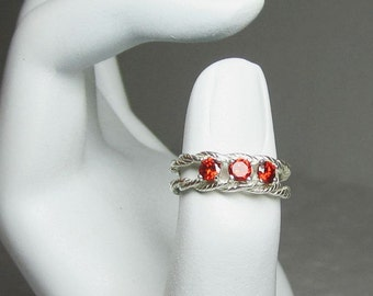Ruby Red Cubic Zirconian Gemstone Ring in Braided Sterling Silver Band