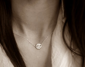 Sterling silver necklace with hammered disc
