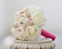 Pink seashell wedding bouquet mini size for flower girl with roses and fuchsia or hot pink pins for beach and destination wedding