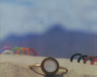 Gucci Watch Original 1993 VINTAGE AD w/ Color Photo of Luxury Timepiece on Beach Sand with Blue Sky