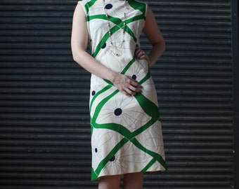 Vintage sleeveless jersey dress in green and white psychedelic floral print, 1970s