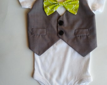 Baby Boy Onesie With Vest Attached And A Bright Green Bow.